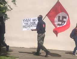 Why was that Holocaust Remembrance Day interrupted by White Supremacists in Arkansas City?